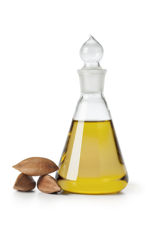 pili: Glass bottle with Pili nut oil and whole pili nuts