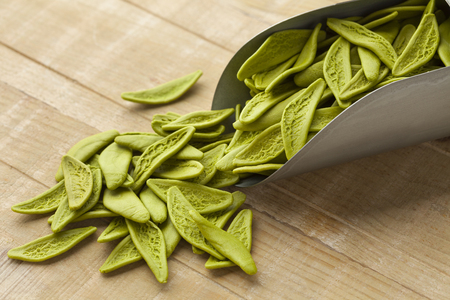 Green Italian spinach paste from Apulia shaped as olive leaves