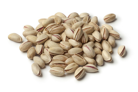 Heap of unshelled pistachio nuts on white background