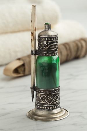 Traditional Moroccan green bottle with black kohl