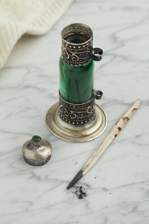 kohl: Traditional Moroccan green bottle with black kohl