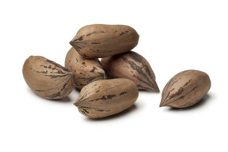 Organic unshelled pecan nuts on white background Stock Photo