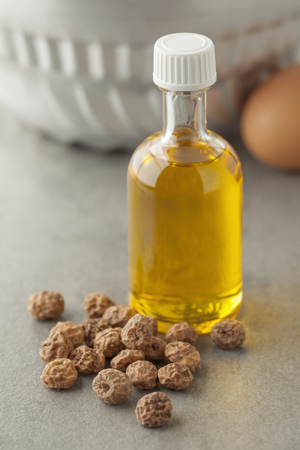 Bottle with Chufa oil and nuts Stock Photo