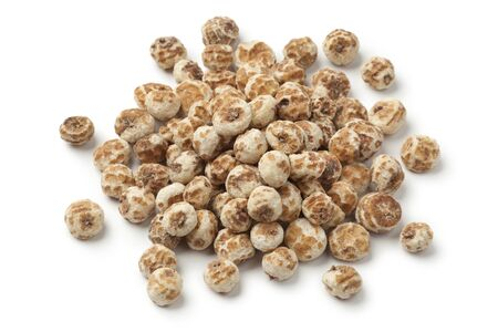 Heap of Chufa nuts on white background