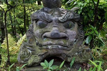 Tokyo, Japan - Guard statue in the garden of the Nezu museum Editorial