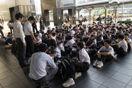 Kyoto, Japan - May 21, 2017: Class of schoolchildren in uniform waiting in the Kyoto station Editorial