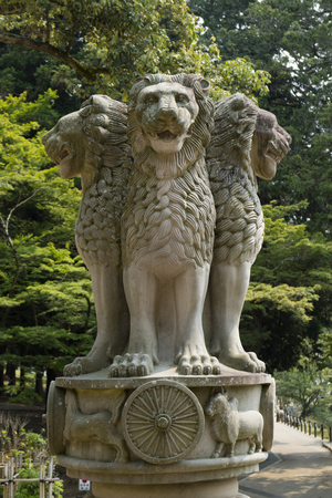 Nara, Japan - May 31, 2017: Stone statue of four lions as symbol of the Indian Emperor Ashoka who dispatched missionaries around the world to spread Buddhist teachings.
