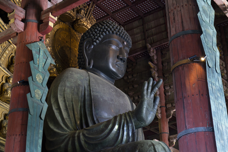 Nara, Japan -  May 29, 2017: The worlds largest bronze statue of Buddha in the Great Buddha Hal, Daibutsuden