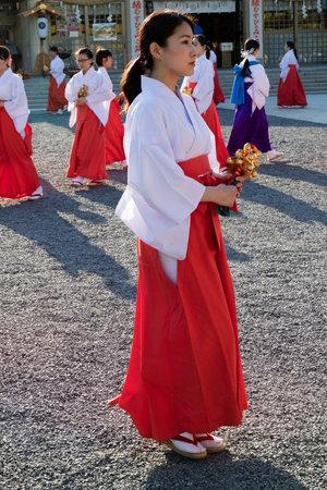 Hiroshima, Japan -  May 27, 2017: Mantō Mitama Matsuri at the Hiroshima Gokoku-jinja Shrine, the spectacle of 100 shrine maidens dancing with bells, suzu, at twilight Editorial