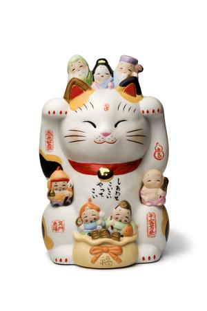 Japanese maneki neko, lucky cat isolated on white background