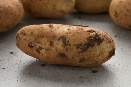 Fresh picked raw whole Diamant potatoes from Cyprus close up