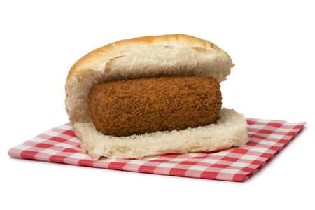 Traditional white bun with a Dutch kroket, called broodje kroket isolated on white background