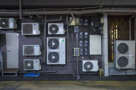 Kumamoto, Japan - November 10, 2018:  Outdoor electricity supply and air conditioning units in Kumamoto