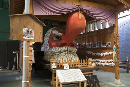 Beppu, Japan - November 3, 2018: Yayoi Tengu, located down Yayoi dori, red male face with a long, phallic nose, it's presence is said to protect the locals Editorial