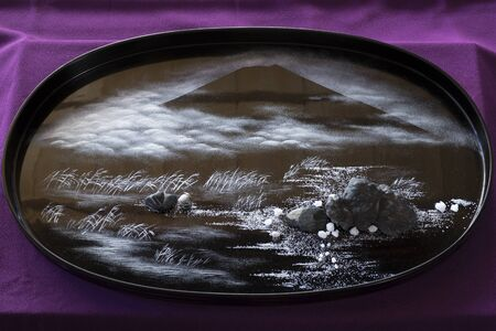 Kumamoto, Japan - November 11, 2018:  Bonseki ,tray rocks, is the ancient Japanese art of creating miniature landscapes on black lacquer trays Editorial