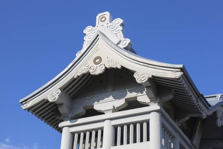 Kumamoto, Japan - November 13, 2018: Detail of the roof of the Niomon Gate at Honmyo-ji Temple is being rebuilt after the earth quake