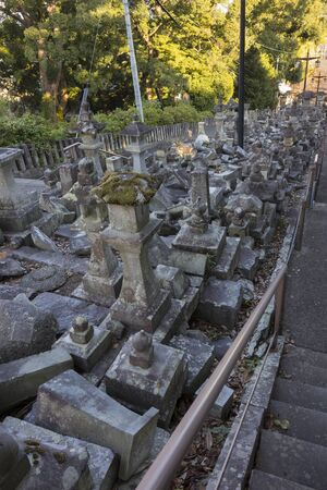 Kumamoto, Japan - November 13, 2018: Broken stone lanterns beside the stairs of the Honmyo-ji Temple after the earth quake in 2016 Editorial