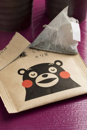 Kumamoto, Japan - January 28, 2019: Paper tea bag with the Kumamon bear, mascot of Kumamoto prefecture.The series of earthquakes that ravaged Kumamoto Prefecture in April 2016 resulted in the increase in products aimed at supporting the affected areas, le