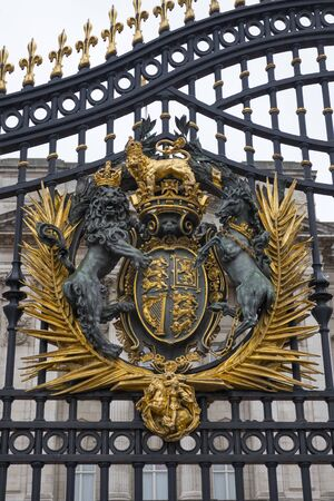 London, England - February 28, 2019, Royal arms on the gate of Buckingham Palace, the London residence of Her Majesty Queen Elizabeth 2nd