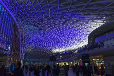 London, England - February 28, 2019: Steel structure of the roof of London Kings Cross railway station at night