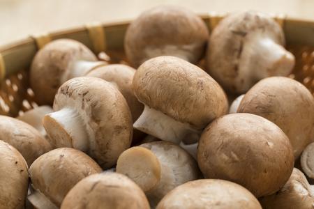 Basket with fresh raw chestnut mushrooms close up Stockfoto
