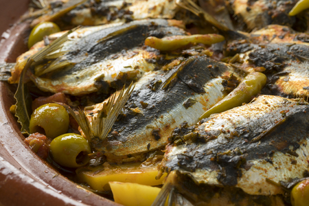Traditional  Moroccan Tagine with stuffed sardines and vegetables closeup