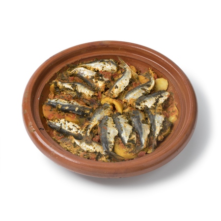 Traditional  Moroccan Tagine with stuffed sardines and vegetables isoloated on white background Zdjęcie Seryjne