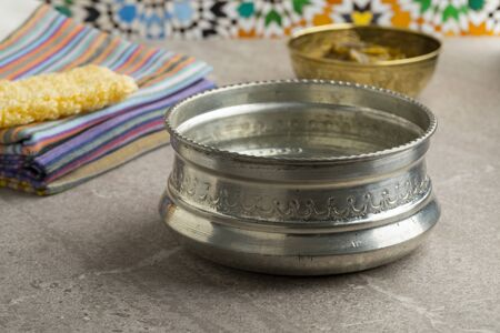 Decorated silver colored metal Hammam water bowl Stock Photo