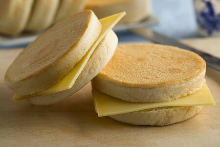 Dutch beschuitbollen, crispy baked roll, with cheese for lunch