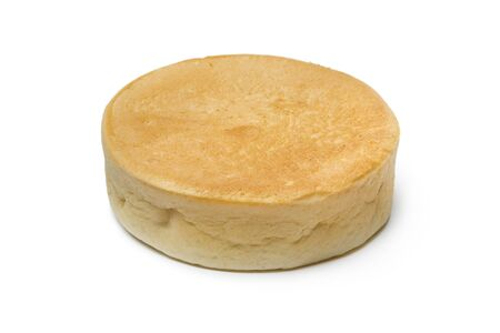 Single fresh baked Dutch beschuitbol, crispy baked roll, isolated on white background Фото со стока