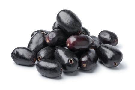Heap of fresh Jamun berries isolated on white background Фото со стока