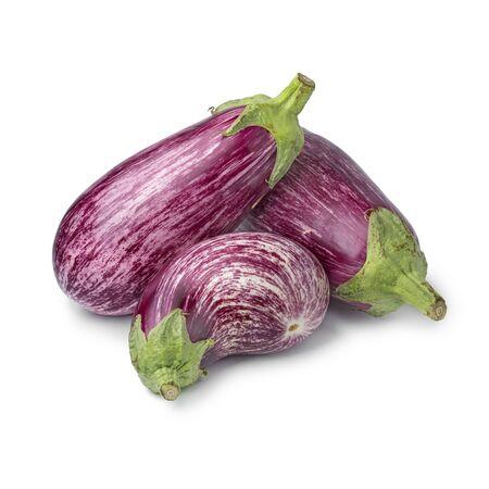 Heap of fresh raw purple striped eggplants  isolated on white background Фото со стока