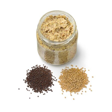 Traditional Dutch mustard with a heap of yellow and brown mustard seed isolated on white background
