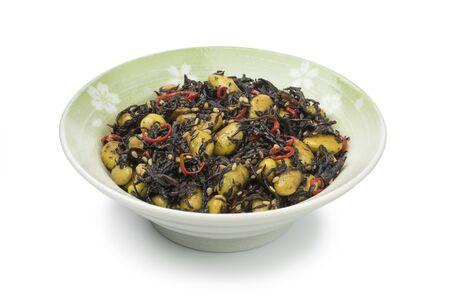 Traditional Japanese bowl with Hijiki seaweed and edamame beans salad isolated on white background