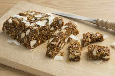 Turkish fig, fruit and nut cake pieces on a cutting board Фото со стока