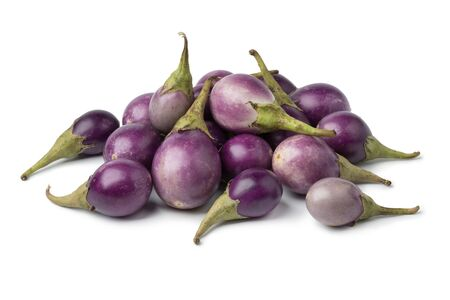 Heap of fresh raw purple mini eggplants  isolated on white background