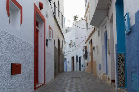 Colorful narrow old street  in the medina of Asilah, Morocco Фото со стока