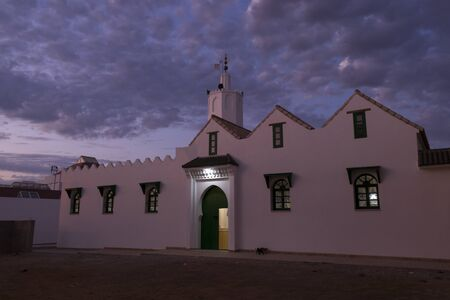 Grand mosque in the medina of Asilah in North Morocco in twilight Reklamní fotografie