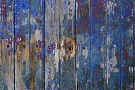 Old wooden grungy textured fence with cracked colors full frame