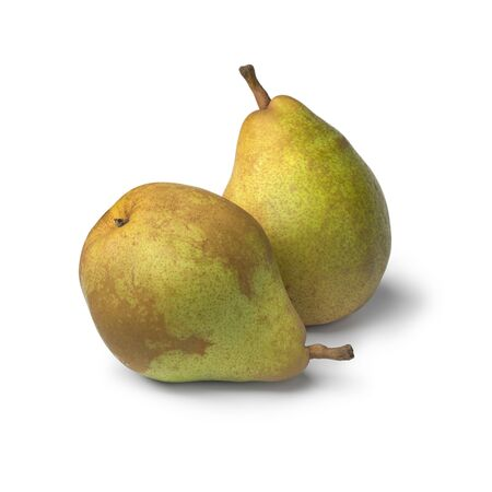Pair of fresh ripe Doyenne du Comice pears isolated on white background Фото со стока
