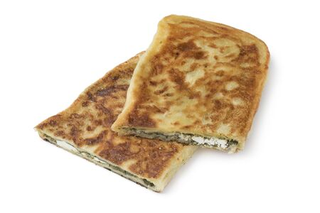 Traditional Moroccan pancake stuffed with spinach and feta cheese isolated on white background