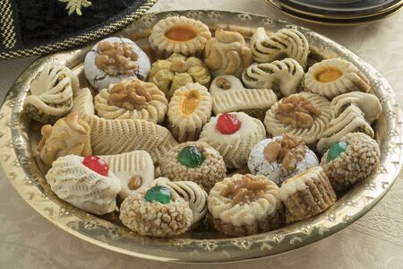 Diversity of traditional festive Moroccan cookies on a tagine dish