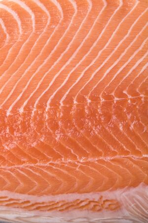 Slice of fresh raw pink salmon filet full frame close up