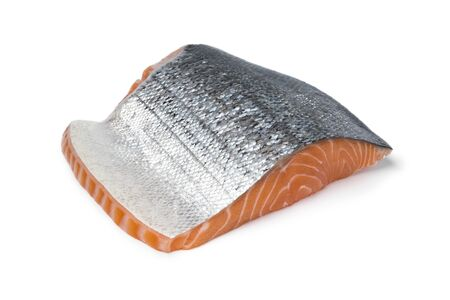 Piece of fresh raw salmon fillet with silver skin isolated on white background
