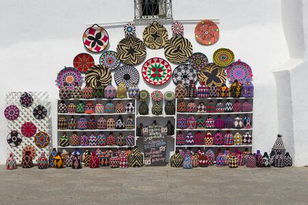 Asilah, Morocco-September 10, 2019: Colorful decorated souvenirs showed on a wall in the medina of Asilah, Morocco Redakční