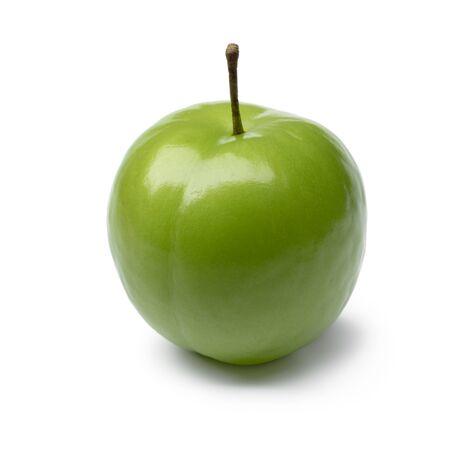 Single whole fresh green Can Erik plum close up isolated on white background