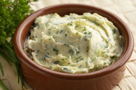 Bowl with fresh made herb butter close up Reklamní fotografie