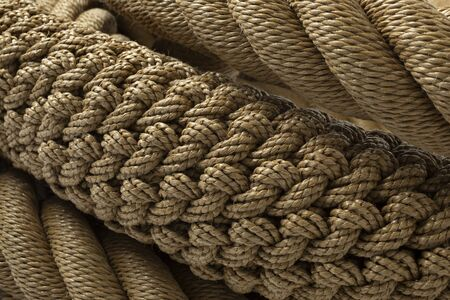 New handmade knotted rope close up full frame with different knots Reklamní fotografie