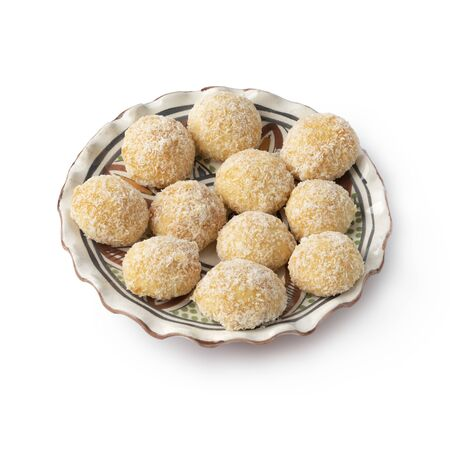 Dish with Moroccan festive homemade coconut cookies isolated on white background