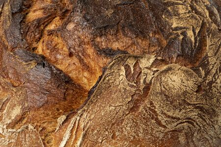 Crust of a fresh baked German farmers bread close up full frame